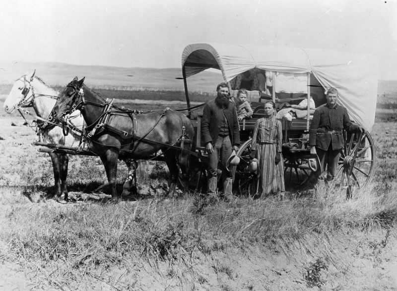 Family with Their Covered Wagon During the Great Western Migration