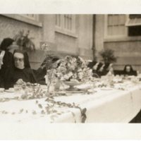 Mother M Aloysia and Mother M Comgerio at a banquet in the convent court
